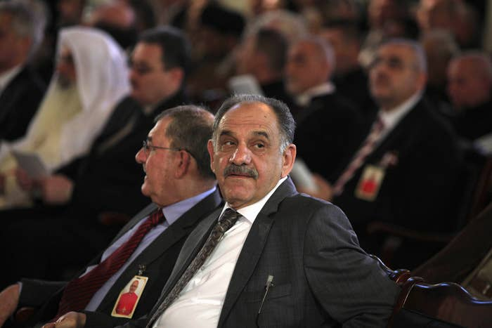 Iraqi Deputy Prime Minister Saleh al-Mutlaq, center, attends an enthroning ceremony at St. Joseph's Church in central Baghdad in March.