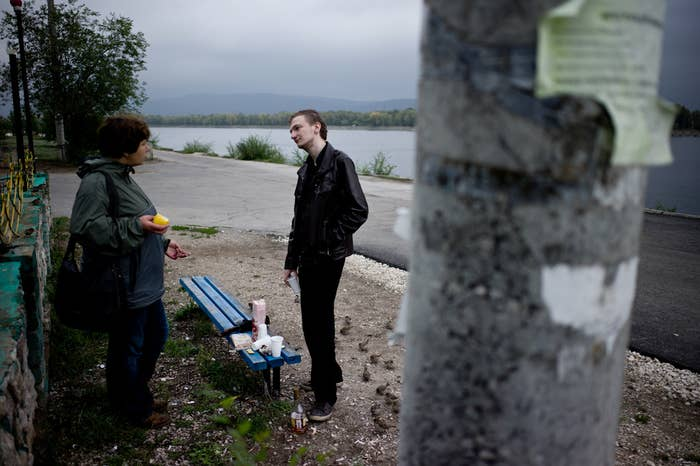 Since coming out, he has been beaten by unidentified thugs, fired from his job, and vilified by national and local media as having desecrated the memory of Soviet victims of WWII by deliberately placing condoms near the city's eternal flame