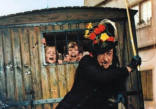 The man is named Child Catcher... you don't need any further proof. Well, there's even mention of murdering two children. This will terrify children for days, especially in today's society.