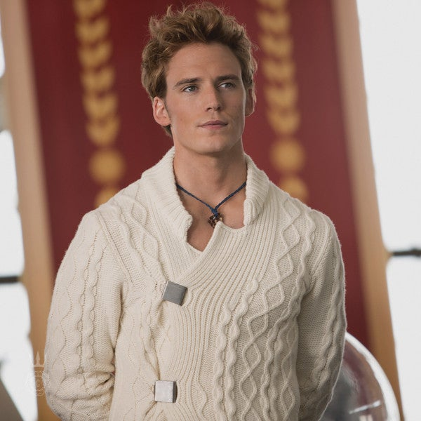 Finnick looked poised and handsome at his Reaping, and that sweater looked insanely comfy. We wouldn't mind cuddling in that thing!