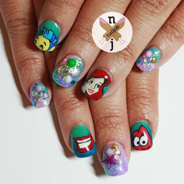 1. Not only is this Little Mermaid mani beautifully painted, it's also  textured with mini shells and charms. (Totally a reason to be where the  people are.) - 16 Examples Of Disney Nail Art That Will Render You Speechless