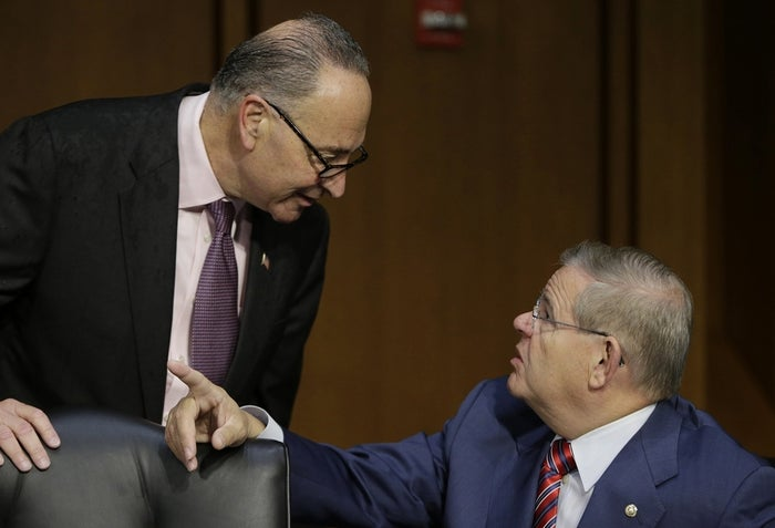 U.S. Senators Charles Schumer (D-NY) (L) and Robert Menendez (D-NJ) (R) talk before U.S. Treasury Secretary Jack Lew (not pictured) testifies before the Senate Finance Committee on the U.S. government debt limit in Washington October 10, 2013.