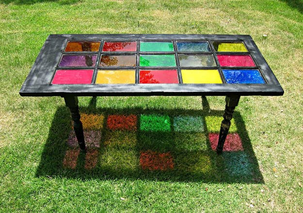 Paint its glass panels in bright hues, then use the door as a gorgeous garden tabletop.