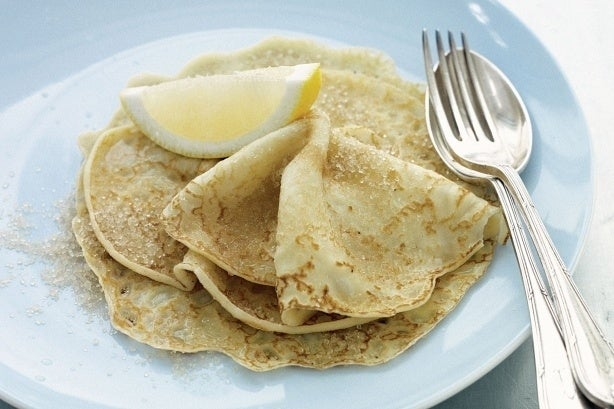 Thin pancakes made with plain flour, eggs, and milk. Traditionally topped with lemon juice and sugar. Like North American pancakes, Brits drizzle it with golden syrup, or like European pancakes, wrap them around savory fillings and eat it as a main course. This traditional recipe is by Kate Tait. Get the recipe.