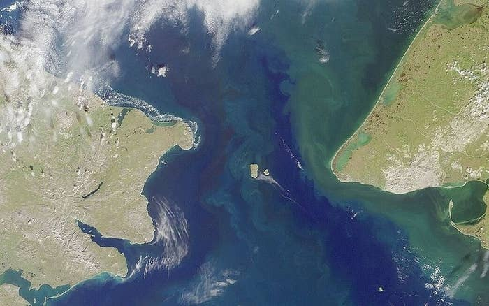Sort of. The Diomede Islands in the Bering Strait contain both U.S. and Russian land (Big Diomede is Russian, Little Diomede is the United States). During winter, an icy bridge forms between them, making it physically possible to walk from one country to the other.