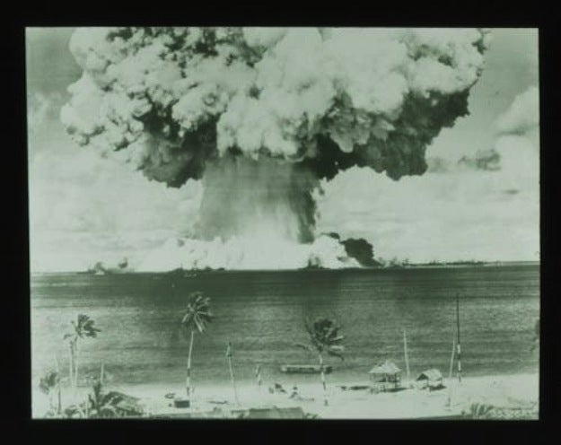 The U.S. conducted at least 67 nuclear tests in the Marshall Islands between 1946 and 1958. The nuclear test conducted at Bikini Atoll on March 1, 1954, Operation Castle Bravo, remains the largest test ever conducted by the U.S. and yielded 15 megatons, almost 1,000 times the power of the bomb dropped on Hiroshima.Bravo vaporized two surrounding islets and sent a plume of highly radioactive debris floating over the lagoon and into the open water. Atolls downwind of Bikini, including Rongelap and Utirik, hadn't been informed of the tests but were showered with dangerously radioactive ash, which residents believed was snow — something they had never seen. In the years following the test, people who were exposed burned from the radiation, became nauseous, developed thyroid problems, had loss of blood cells, and women who were pregnant miscarried. And decades after the bombings, the health problems persist with unusually high rates of birth defects and cancer among Micronesians.Even today, the fallout impacts the environment, where it is remains unsafe to eat coconuts, other crops, and fish around these islands. As a consequence, most Bikinians have given up the dream of ever returning to their home, and many Micronesians have left their islands for America. The anniversary of Operation Castle Bravo is a national day of mourning in the Marshall Islands.