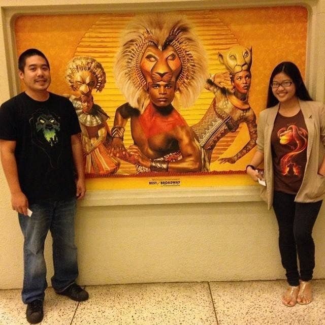 Just look at these two adorable lovebirds rocking their Lion King tees with pride!