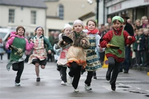 Many towns in the UK celebrate the holiday with pancake races, where contestants must run while tossing a pancake in a frying pan (and, typically, wearing a silly hat). Each contestant must flip the pancake at least three times during the race. Even Parliament has its own annual pancake race, to raise money for the disability charity Rehab.