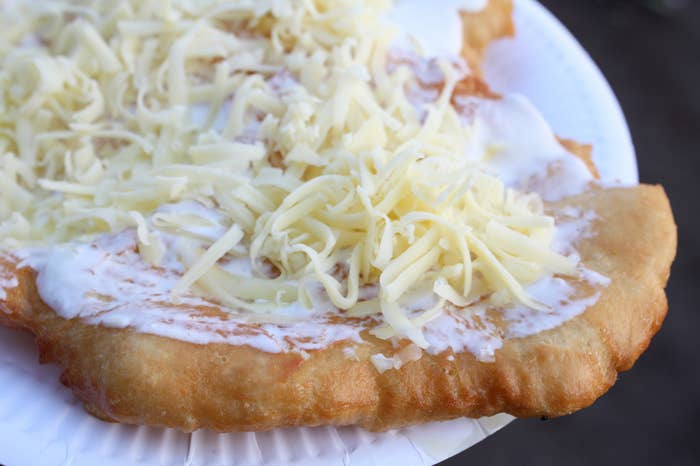 "What it is: A plate-sized sheet of fried dough that is usually smothered with sour cream and cheese. Other possible toppings include garlic sauce or ketchup.Why it's awesome: Did you miss the part where I wrote ""fried dough""?!Get a recipe [here]."