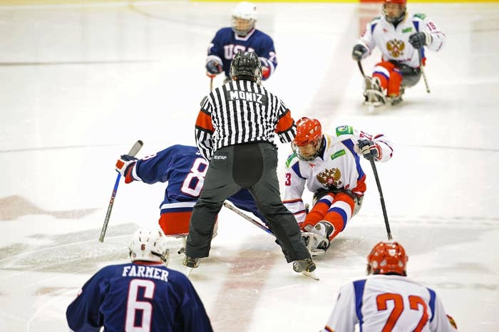 """Sled hockey is played as aggressively as """"stand-up"""" hockey, on a regulation-size rink -- but the players are strapped into sleds and have two sticks."""