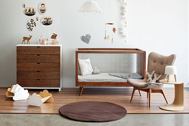 This sleek, gorgeous nursery, featuring natural wood and a neutral palette, is a Danish modern fan's dream.