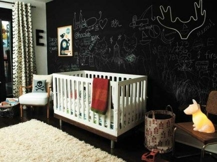 A chalkboard wall allows you to change up the doodles and drawings on a regular basis, and will be a lot of fun for baby once he or she starts to draw.
