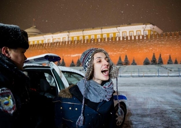 LGBT activist Elena Kostyuchenko (above) is arrested in Moscow on Friday during a protest in Red Square.