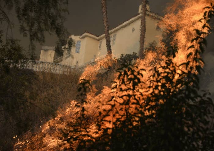 The Colby Fire burns near homes, in the hills of Glendora, Calif. on Jan. 16.