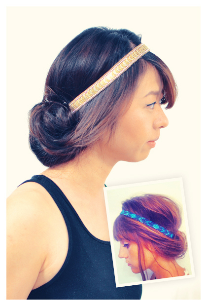 Roll your hair up into an elastic hairband.