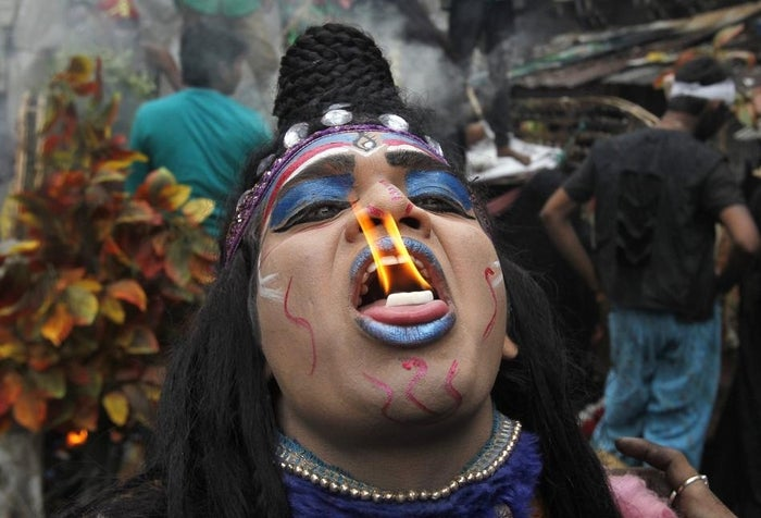 A man dressed as Lord Shiva performs with fire during Shivratri celebrations in Allahabad.
