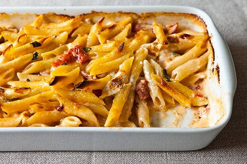 5 cheeses, count 'em. Serves 42 cups heavy cream1 cup chopped canned tomatoes in heavy puree1/2 cup freshly grated pecorino Romano cheese, (1 1/2 ounces)1/2 cup coarsely shredded (1 1/2 ounces) Fontina cheese1/4 cup crumbled Gorgonzola cheese, (1 1/2 ounces)2 tablespoons ricotta cheese1/4 pound thinly sliced mozzarella cheese3/4 teaspoons kosher salt, plus more for pasta water6 fresh basil leaves, coarsely chopped1 pound penne rigate or conchiglie rigate4 tablespoons (1/2 stick) unsalted butter, sliced thinly1. Heat oven to 500 degrees F. 2. Bring a large pot of salted water to a boil. 3. In a mixing bowl, combine all ingredients except the pasta and butter. Stir well to combine.4. Drop the pasta into the boiling water and parboil for 4 minutes. Drain in a colander and add to the ingredients in the mixing bowl, tossing to combine. 5. Divide the pasta mixture among six to eight shallow ceramic gratin dishes (1 1/2 to 2 cups in capacity) or place in a shallow (1-inch) layer in larger baking dishes. Dot with the butter, and bake until bubbly and brown on top, 7 to 10 minutes.Save and print the recipe on Food52.