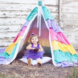 Making a homemade tent like this ruffled teepee is just one DIY way for little ones to enjoy the outdoors. Plus, sun protection has never looked quite this fabulous.