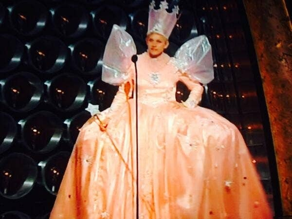 After a commercial break, Ellen took to the mic dressed up as Glinda, the Good Witch of the North. Shimmering crown, wand and all!