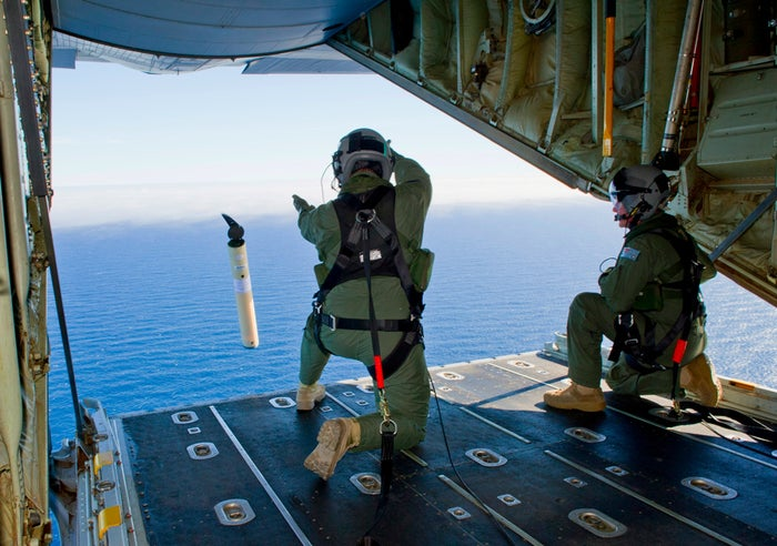 Royal Australian Air Force members launch a Self-Locating Data Marker Buoy from a C-130J Hercules aircraft in the southern Indian Ocean.