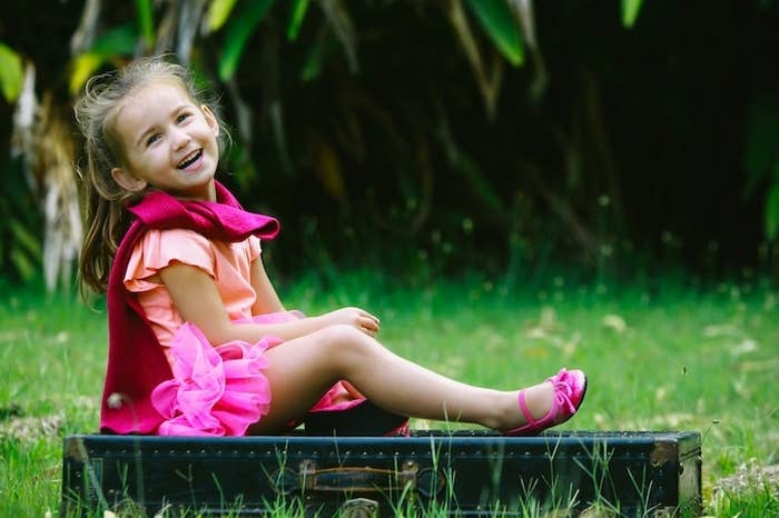 """Kids tend to smile unnaturally when asked to say """"cheese."""" Instead, try to capture a natural smile by making them laugh, which looks a lot better on film."""