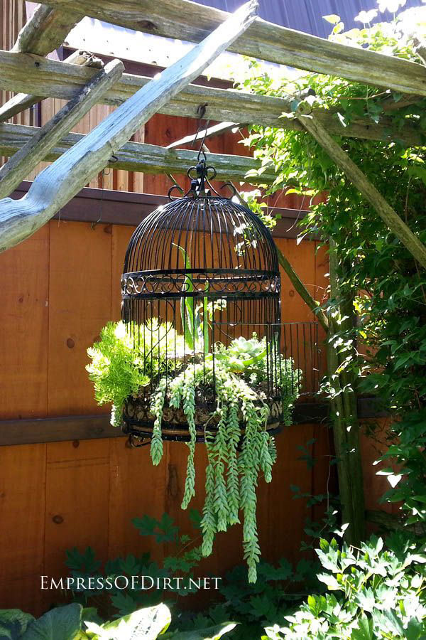 ... ! There are lots more ideas for unusual garden art containers here