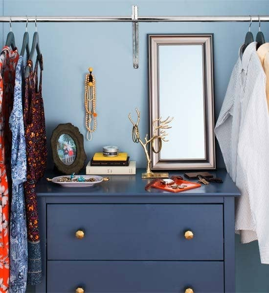 If you've got the space, repurpose a chest! Drawer systems can be short on charm. Instead, see if you can slide in a small dresser or lingerie chest for socks, ties, and underwear. Top it with a dish to catch pocket change, a jewelry organizer, and a snapshot from your last vacation; as you dress for work, you can always dream. RELATED: How to Gain More Closet Space Without Renovating