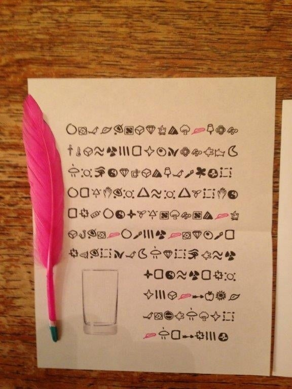 There are about 50 different characters, which probably makes a straightforward symbol-for-letter substitution unlikely.