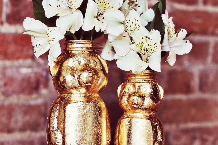A little bit of gold paint turns just about anything, even used honey bottles, into standout end table accessories!