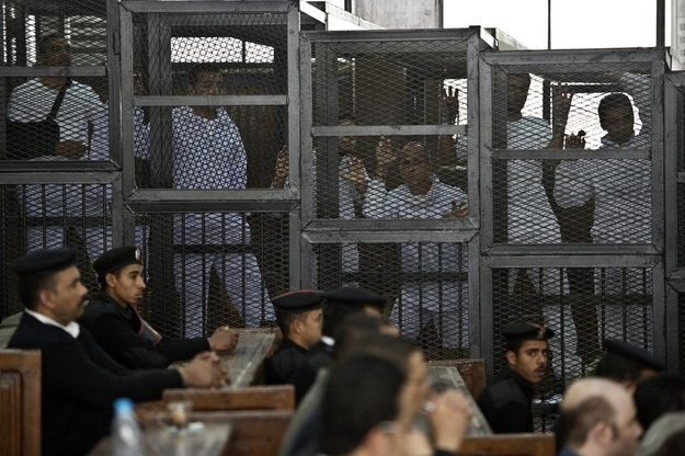 Disturbing Photos Of Journalists In A Cage During Their Trial In Egypt