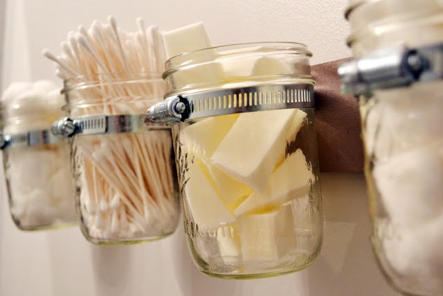Get organized by stashing your bathroom beauty tools in a cool hanging mason jar storage piece.