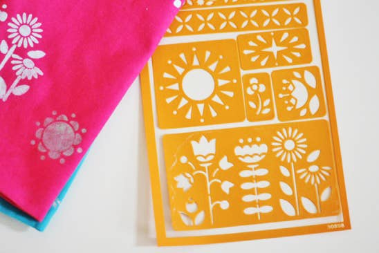 Add some sunshine to basic kitchen towels with some stencils and a few dabs of paint.