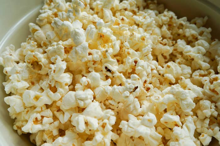 Seems obvious but air popped or light popcorn is insanely low calorie. Spruce it up with cinnamon & a little sugar or Splenda/Stevia), parmesan, truffle oil, spices, the sky is the limit! Either go for a light brand like Bearitos No Oil, Newmans 94% Fat Free or other low-oil variety OR make your own! Its easier than it sounds: http://www.simplyrecipes.com/recipes/perfect_popcorn/
