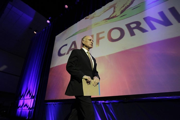 California Gov. Jerry Brown walks on stage to speak at the 2014 California Democrats State Convention at the Los Angeles Convention Center March 8.