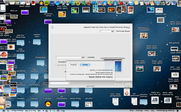 Flip a computer display screen upside down.