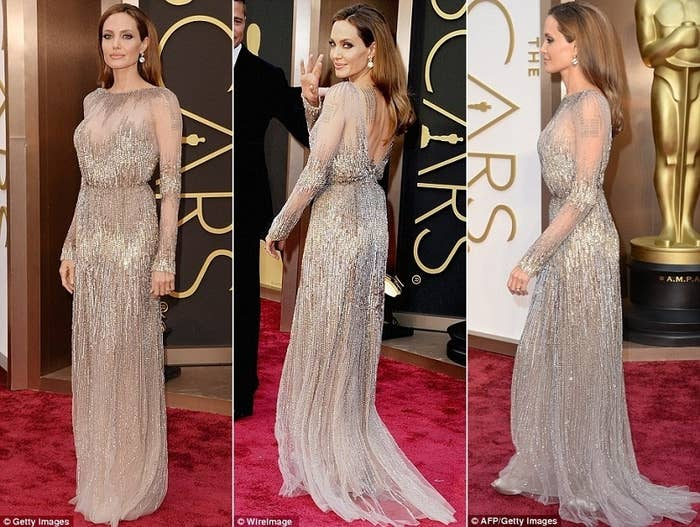 Besides her impeccable posture, Angelina has a certain regal-ness about her in this metallic Elie Saab dress. The dress appears conservative but the hints of skin and tattoos underneath the mesh sleeves and the daring back makes for a MOTB dress no one will forget. Mama's still got it!