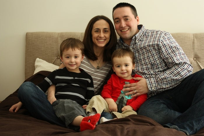 Greg, with his wife, Charity, and sons, William, 3, and Charlie, 22 months.
