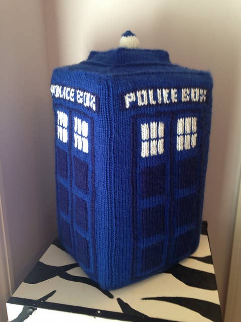 """Slide some cardboard inside to keep its shape, or stick to stuffing for a cuddlier TARDIS. If you want to get really fancy, you can get a recordable sound chip to sew inside for that classic """"EERrwWwoooooSHHHhEERrwWwoooooSHHHh EERrwWwoooooSHHHh"""" sound when you squeeze it.Pattern Found Here."""