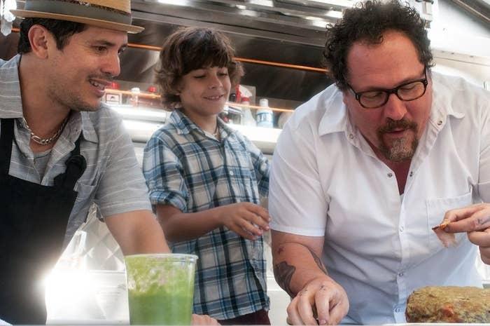 John Leguizamo, Emjay Anthony, and Jon Favreau in Chef