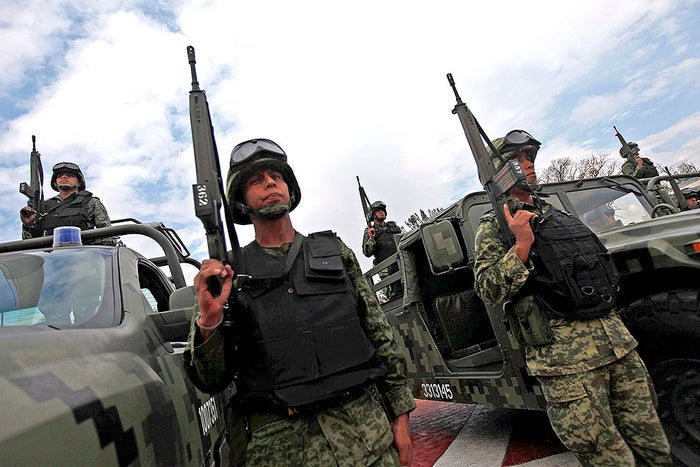 Mexican military personnel carrying G3 long arms similar to those carried by two alleged Mexican soldiers who illegally entered U.S. territory in January. The soldiers pictured were photographed in Ecatepec, Mexico, in 2013.