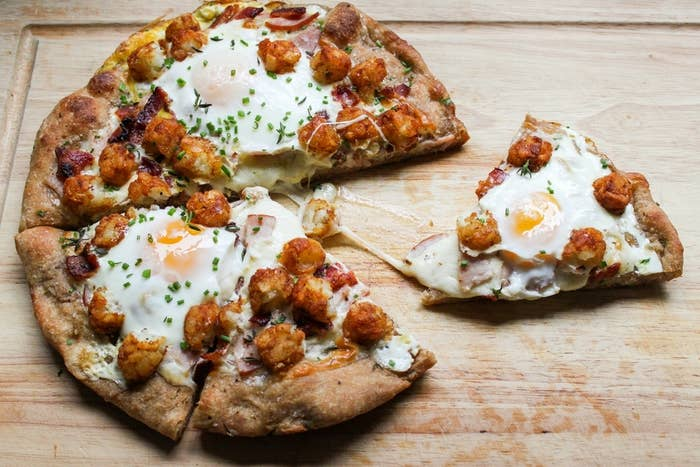 You're seeing what I'm seeing, right? There are tater tots ON that pizza. And also eggs. [Faints]. Get the recipe.