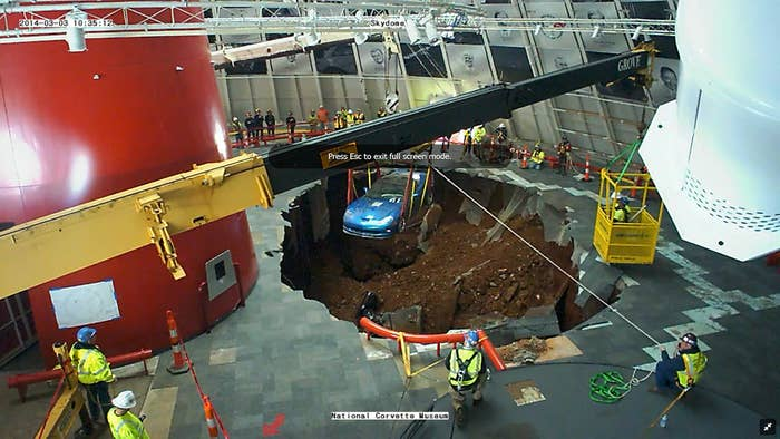 "First corvette HAS BEEN RESCUED from National Corvette Museum Sinkhole, a 2009 #Corvette #ZR1 ""Blue Devil."". Here is photo as it happened a minute ago, viewed through the Corvette Museum's live webcam video feed inside the SkyDome."