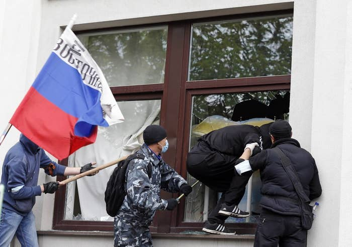 Pro-Russian activists attack the regional administration building in Luhansk, eastern Ukraine, April 29.