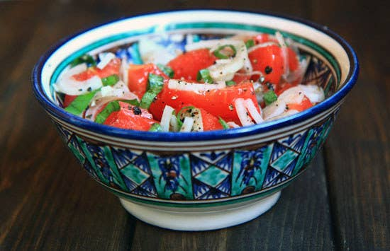Uzbek cuisine doesn't offer much for the diehard vegetarian, but this dish made up of thinly sliced tomatoes and onions seasoned with spices offers a light, healthy, but still flavorful option.