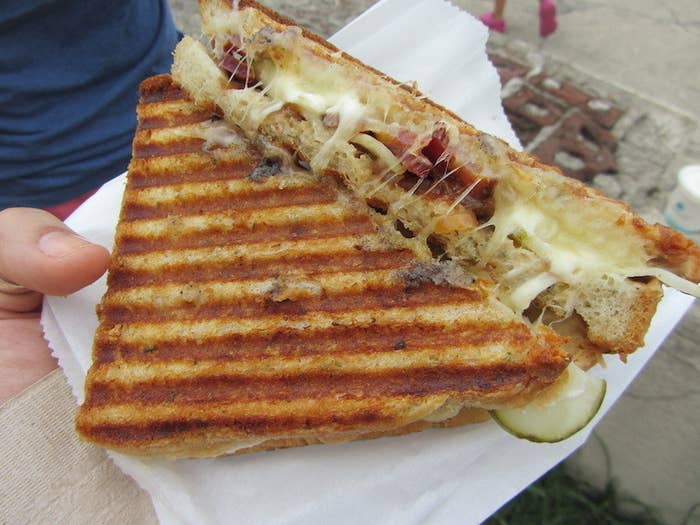 These guys take an ordinary grilled cheese and mix it up by adding tasty ingredients like dijon mustard, pickled onions, and Granny Smith apples. Pair that with some gruyere, blue cheese, or sharp chedder on locally baked bread, throw it on the panini press until it's perfectly browned and you've got one absolutely mouthwatering sandwich. The merging of the crunchy bread, melted cheese, and savory toppings is like a party in your mouth. After tasting one of these, you'll never want to have a grilled cheese any other way again.They're also known for their awesome mac 'n' cheese and thick milkshakes. It's a surprisingly delicious duo: a grilled cheese and milkshake.Follow them on Twitter @milktrucknyc for daily truck locations.Top Pick:- Milk Truck Classic with bacon. Noms.You Should Also Try:- Tahitian & Madagascar Vanilla Bean milkshake- Bacon Cheddar Blue sandwich
