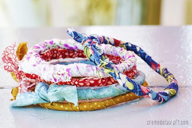 Put those unused flimsy dry cleaning hangers to good use with 10 minutes and a few left over fabric scraps.