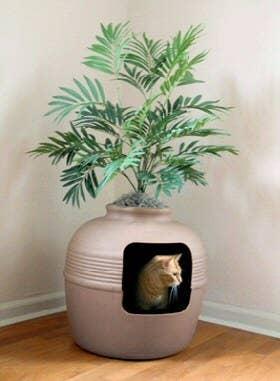 Camouflage the litter box while giving your cat a little privacy. A brilliant bargain at $64.95 here.