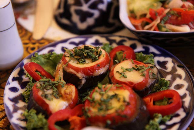In Uzbek tradition, a meal usually starts off with some sort of salad appetizer, like this dish that combines freshly sliced eggplant, radishes and peppers on a bed of greens sprinkled with a garnish of parsley. Needless to say, most Uzbek dishes are meant to be shared family-style.