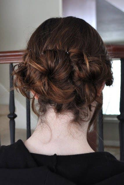 21 ridiculously easy hairstyles you can do with spin pins 1 nestle those buns together to create something interesting solutioingenieria Images