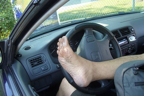 This is a state-wide law. I always made fun of this one -- whenever I drive places with my friends, I make sure to warn them about their seatbelts and to make sure they had their socks and shoes on. Seems just a bit too excessive, right?